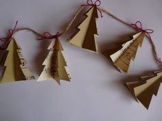 folded christmas tree paper garland on twine...the tree shapes are sewn together. What other shapes could you do with this technique?  butterflies, stars, hearts