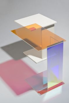 The dichroic version of the ABCD cantilevered side table, made by Prinz Optics GmbH in Germany out of 6mm Borosilicate glass that's coated with an inorganic dichroic filter.