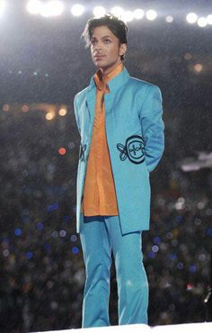 Prince after the awesome performance at Super Bowl in the rain. He gave his all!