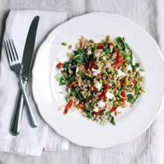 A simple farro salad with beet greens, chevre, and sun-dried tomatoes.