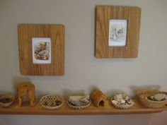 Seasonal postcards in frames and loose parts for play
