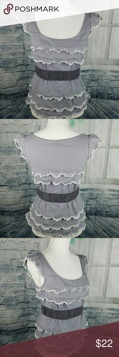 """Floreat Anthropologie Tiered Gray Top Gray tiered ruffle cap sleeve top size 6. Gently worn, no defects. Measurements  Chest from armpit to armpit 16"""" Length from top of shoulder to hem 22""""  Please comment if you have any questions. Thank you! Floreat Anthropologie Tops Blouses"""