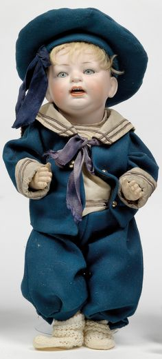 Old porcelain doll in sailor suit