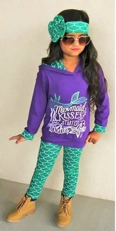 Mermaid Kisses 3 Piece Set: From school to the playground your little fashionista will be center of attention in this adorable Mermaid Kisses 3 piece set.  Includes hoodie top, leggings and matching headband. TheChicFind.com