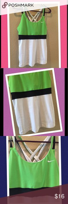 "🌷Nike sports top chic gorgous🌷 Beautiful color combinations.  Cross straps.  Comes with bra.  Fits S-M.  From top of straps to bottom 24"" armpit across 16"" stretch fabric  ❣️ I am open to all offers BUNDLE & send me your offer😍 Nike Tops Tank Tops"