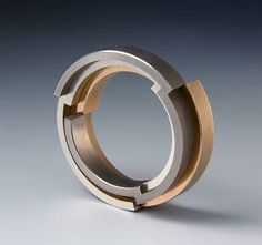 The ring can be broken down into its three parts. Gold, silver and Titanium