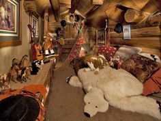 Tiny claimed space under the eaves of the log home for a kids playroom - how cute is this?  Little imaginations go wild in a spot like this!
