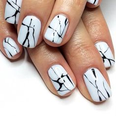 Nothing like making your nails into your personal works of art with water marble nail art design using white as your base color and black for the dripping details.
