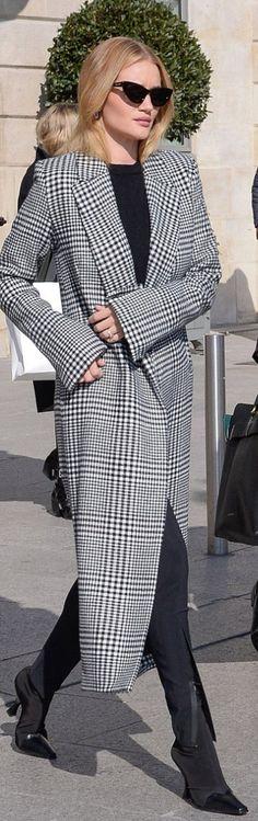 Who made  Rosie Huntington-Whiteley's black sunglasses, white plaid coat, handbag, luggage, and boots?