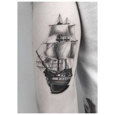 Full-rigged ship tattoo on the right arm.