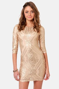 "Go for ""Baroque"" wrapped in the stunning embellishments of the TFNC Basma Gold Sequin Dress! Stretchy beige mesh houses intricate patterns of matte gold sequins that align over a body-con silhouette and three-quarter sleeves. Rounded neckline. Removeable shoulder pads. Fully lined. Hidden back zipper/hook clasp. Model is wearing a size small. 100% Polyester. Fabric: 94% Polyester, 6% Elastane. Lining: 97% Viscose, 3% Elastane. Hand Wash Cold. Imported."