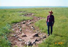 Snake Effigy, South Dakota. In this 1997 photo, Royal Runge, the rancher who formerly owned the Medicine Knoll site from 1938 until 1999 and took care to preserve it, is shown here alongside the snake mosaic made of stones that archaeologists believe is close to 500 years old.