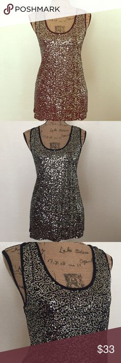 Black Shiny Sequins top PERFECT FOR NEW YEARS EVE! Sleeveless black sequins top very cute & sexy perfect for night out shiny out more at night one of my best tops get always compliments from it all great condition premise studio Tops Tank Tops