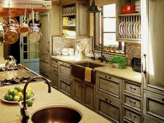 Traditional (Victorian, Colonial) Kitchen by Suzanne Tucker -love this but Ièd use two cast iron farmstyle sinks with colonial style faucets