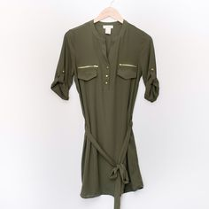 Olive Belted Dress This adorable dress is calling your name! Also available in navy. 100% polyester. Dresses