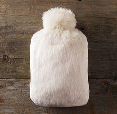 luxe faux fur hot water bottle - looks like a cuddly sheep omg!