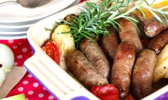 Turn everyday sausages into something special with this sausage, apple and rosemary bake. The apples and tomatoes break down during baking to create a tasty, tangy sauce to serve with the sausages.