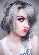 Stunning gray. Bleach hair until you get the lightest color possible. Get Wella T14 aka Silver Lady add two capfuls of Cooling violet by Wella 050 and leave the toner on your hair for close to 30-40 mins depending on your porosity.