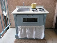 entertainment stand turned play kitchen... what a great idea. Via Out of the Crayon Box