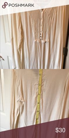 Cheese cloth comfy long shirt Loose fitting. Great with leggings. Has roll up button sleeves and unique stitching embellishments Free People Tops Blouses
