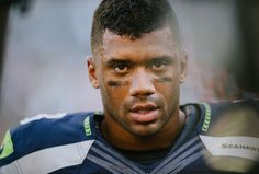 """Seahawks quarterback Russell Wilson's """"Pass The Peace"""" campaign aims to support victims of domestic violence through his """"Why Not You"""" foundation."""