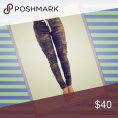Cute chic camo joggers/pants💁 These are a stylish pair of pull on camo pants. They have a lightly distressed style with zippers on the legs. Ruched from the knees down. A very snug fit. Fit like shown in the picture. Size is a SMALL. But I would say fits more like a size junior 0 or 00. 5 pockets. Low rise jogger. 97% COTTON 3% SPANDEX 13 inches laid flat. 35 inches in length🚫NO TRADES🚫NO OFFLINE TRANSACTIONS🚫LOWBALLING American Bazi Pants Track Pants & Joggers