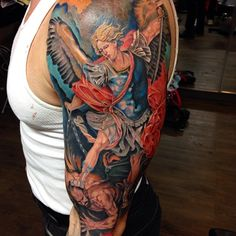 Half sleeve colour St. Michael tattoo