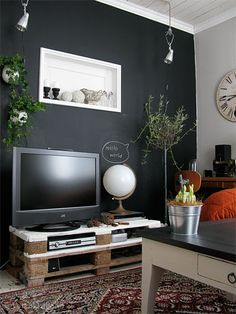 Like the idea of the black wall in the TV room and the persian rug to make it more cozy