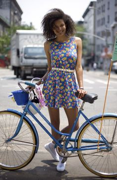 Lovely blue town bike with rider in beautiful floral print dress, finished with white pencil belt. Cracking hair job too! Thanks for sharing this pin. MAKETRAX.net - Bicycle STYLE RIDERS