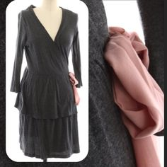 """Anthropologie Dress Gray jersey wrap dress from Eloise for Anthropologie. Two tier skirt with interior tie to keep the wrap secure. Pretty rose colored silk tie at the waist. 36.5"""" long. Like new condition - no flaws.  Stock pic from Lyst. Anthropologie Dresses Midi"""