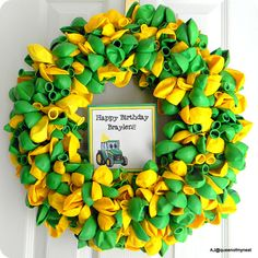 Ballon Wreath - Approx. 288 ballons. Buy an 18-inch straw wreath and leave the plastic wrap on. Use floral pins (find in artificial flower section at craft stores) and pin balloons all over wreath. Can add ribbons/tulle, if so desired.