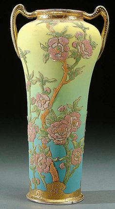 A NIPPON CORALENE DECORATED PORCELAIN HANDLED VASE CIRCA 1909 WITH BEADED GLASS DECORATION OF WILD ROSES ON A LIME TO BLUE SHADED SATIN GROUND
