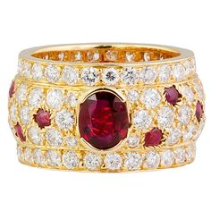 CARTIER PANTHERE Diamond Ruby and Gold Band | From a unique collection of vintage band rings at http://www.1stdibs.com/jewelry/rings/band-rings/