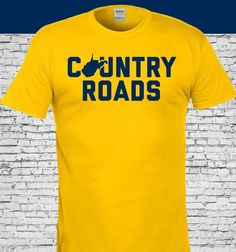 West Virginia Mountaineers Country Roads Gold Shirt Wv Logo, West Virginia University, New West, Fan Shirts, Cricut Design, Country Roads, Sweatshirts, Mens Tops, Gold