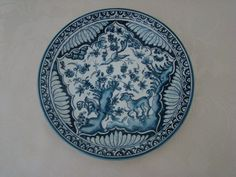 Beautiful vintage blue and white, hand painted and signed, ceramic plate from the Coimbra region in Portugal. The hand-painted pattern is based on a typical Portuguese design from the 17th century and includes flowers, birds, and a dog.  Lovely condition, no chips, cracks or crazing.  The plate is 21 cm in diameter.  Please see all the pictures as they form an important part of the description.
