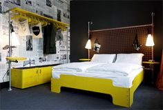 The Superbude 2 Hotel Revives The City's Industrial Flair With Its Design #yellow #newspaperwall