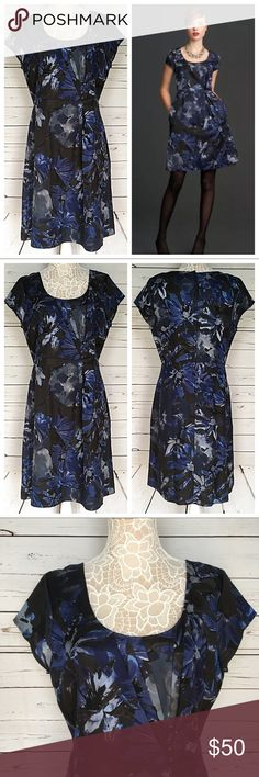 Banana Republic Mad Men Blue Floral Dress 16 NWT Banana Republic Mad Men Collection dark blue floral dress, size 16. Knee-length, scoop neck, cap sleeves. Lots of thoughtful details such as a full lining, covered back zipper with ribbon pull, and lingerie snaps at the shoulders. New and unworn with tags!   Price firm unless bundled.  Fast shipping! I ship daily Monday-Friday. Banana Republic Dresses