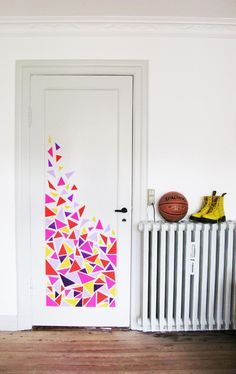 Door Decs!! I like the wall decals put only partially on the door...a cool artsy look...