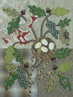 The Civil War Bride Quilt: Red bird under the leaves.....