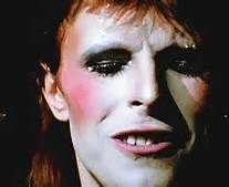 david bowie 70s  make up on stage