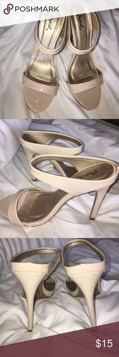 Cream patent stiletto sandals My daughter bought these cute, fun high heeled sandals and never wore them! They're slightly scuffed on bottom from in store and at home try ons. Left heel has a small scuff on it, pictured above. New without tags or box. Make me an offer! Qupid Shoes