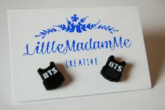 This listing is for 3D printed stud earrings of the BTS bulletproof jacket logo which I recreated in SketchUp and printed using black and white PLA filament on my Flashforge Creator Pro 3D printer.  Its a simple design, consisting of the black silhouette of the jacket with the BTS lettering popping out in white.