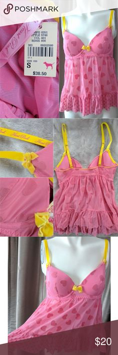 Victoria Secret Heart Pink Babydoll Bustier Small VS Pink baby doll heart top has soft yellow adjustable straps, underwire cups, with soft heart cutouts all over.  95% Nylon 5% Spandex. Hand wash.  New with tags in excellent unworn condition, coming from a smoke free home. Victoria's Secret Tops Camisoles