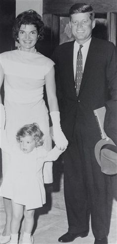 Sen. John F. Kennedy, accompanied by his wife Jacqueline and daughter Caroline, pictured at the Half Moon hotel and cottage colony where they vacationed recently.