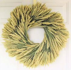 Beardless Wheat Wreath will really spice up your walls.  From drieddecor.com