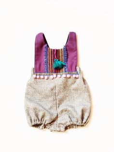 This limited edition romper has been created with fabulously soft vintage fabrics and trims.  The waistband, shoulder straps, and legs are soft, flexible elastic for a comfortable and an adjustable fit. The exact content of the vintage fabrics are unknown. Fabrics have been prewashed in hypoallergeni