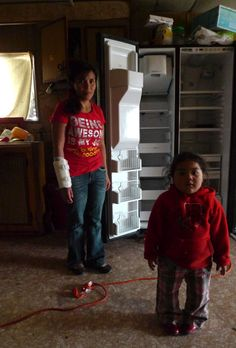 Residents, most of them farmworkers, of the Valenzuela mobile home park in the Coachella Valley have been without electricity since January 9. (Lisa Morehouse/KQED)