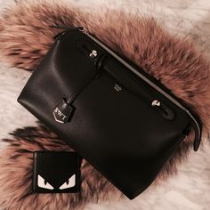 Black Fendi By The Way bag with SS15 Monster wallet with raccoon fur stole.