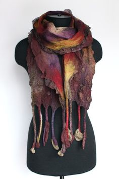 Unusual and unique. Abstract and luxury. It will emphasize your individuality!  Soft, long and oh so textured.  Fine accessory for yourself or as