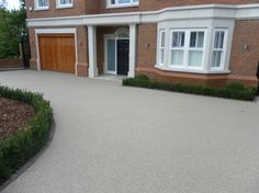 A Clearmac® resin bound driveway looks fantastic, is permeable/SUDS compatible & requires minimal maintenance.